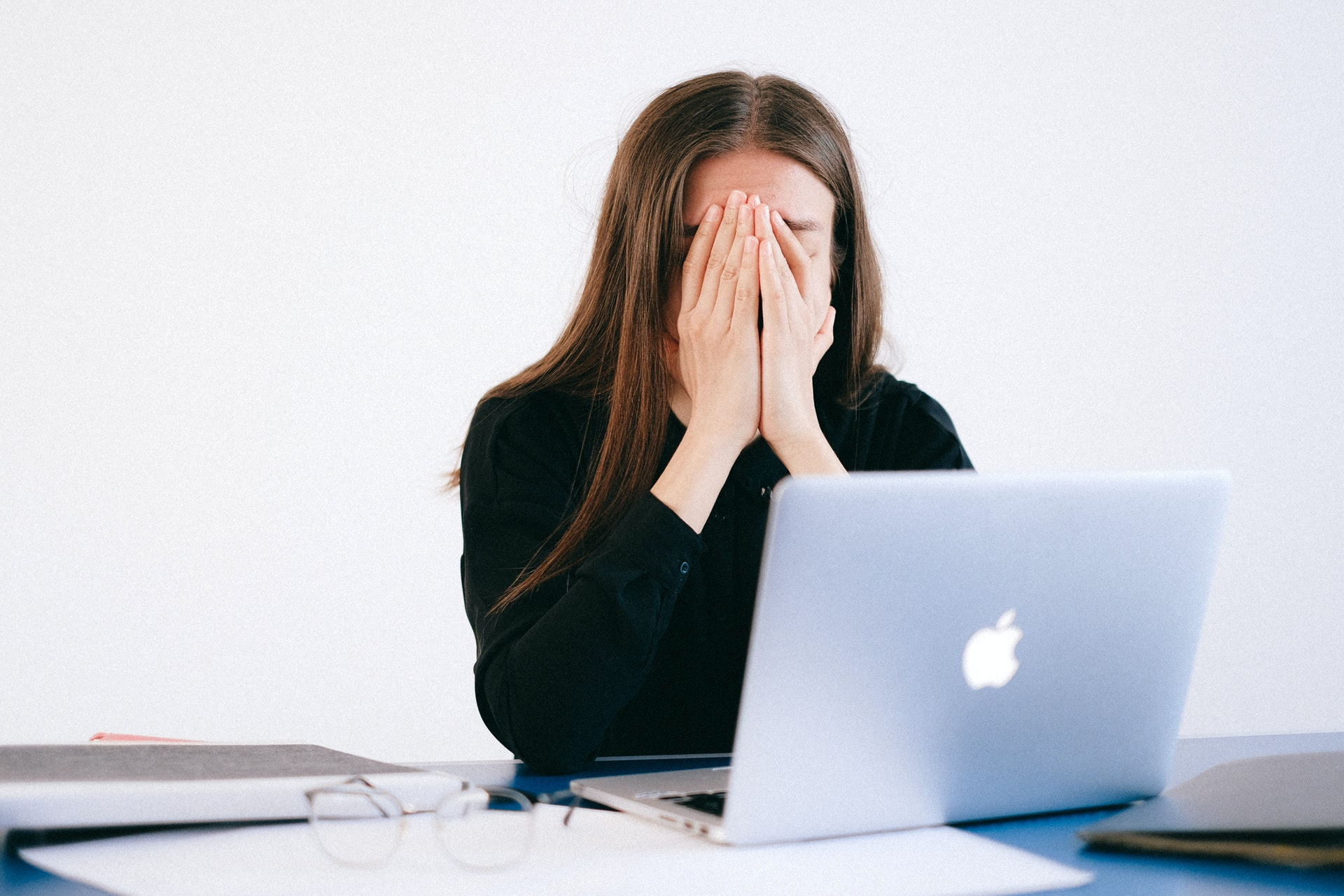 Stressed woman covering her face