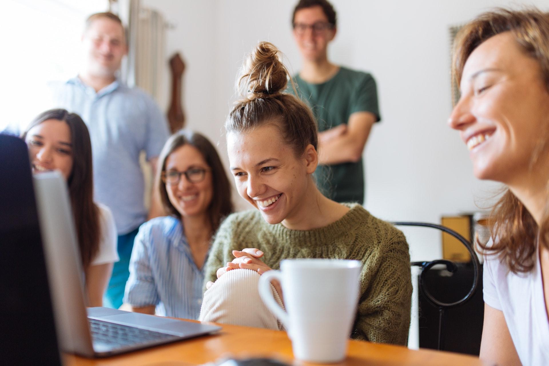 People smiling at laptop