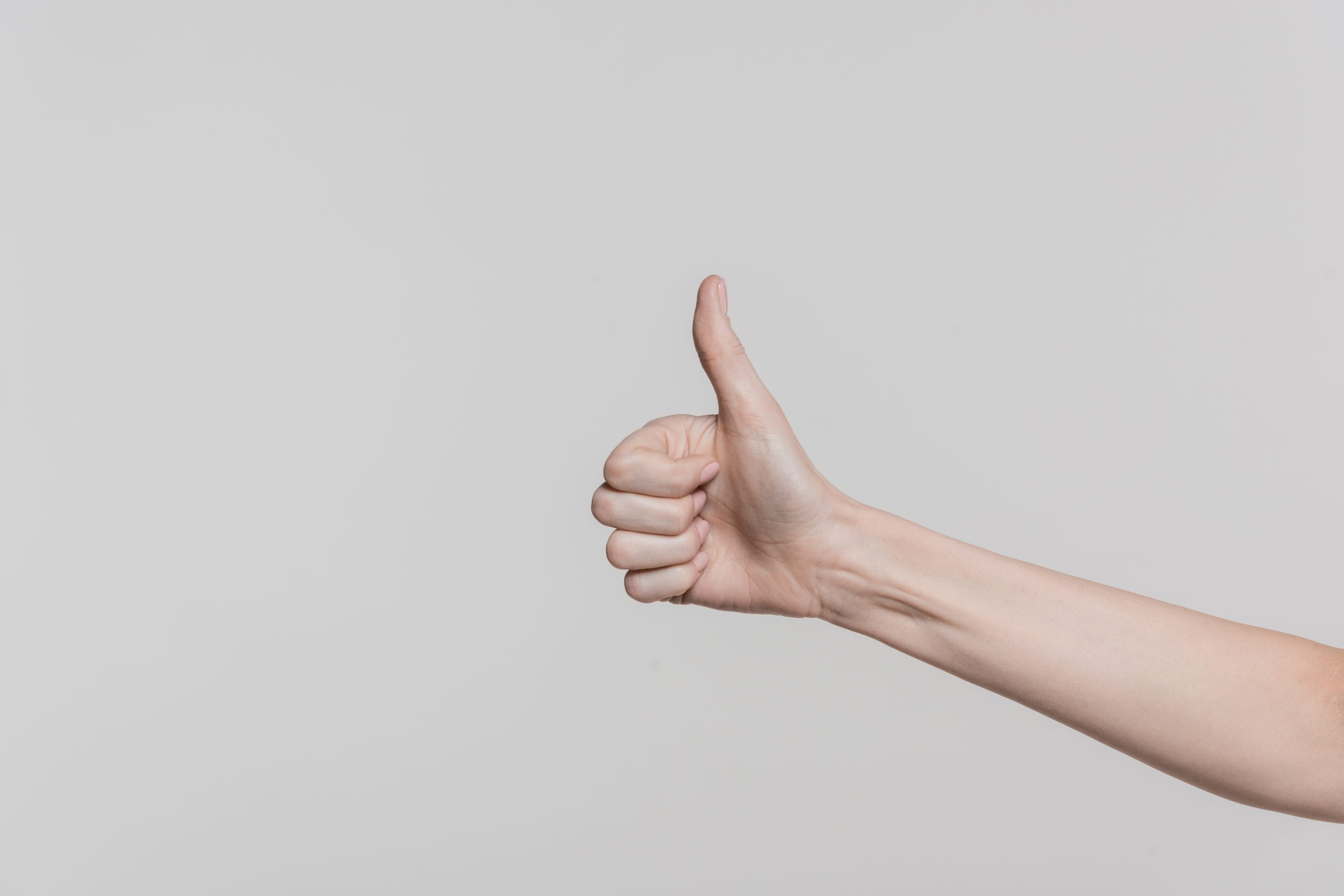 Person showing thumbs up