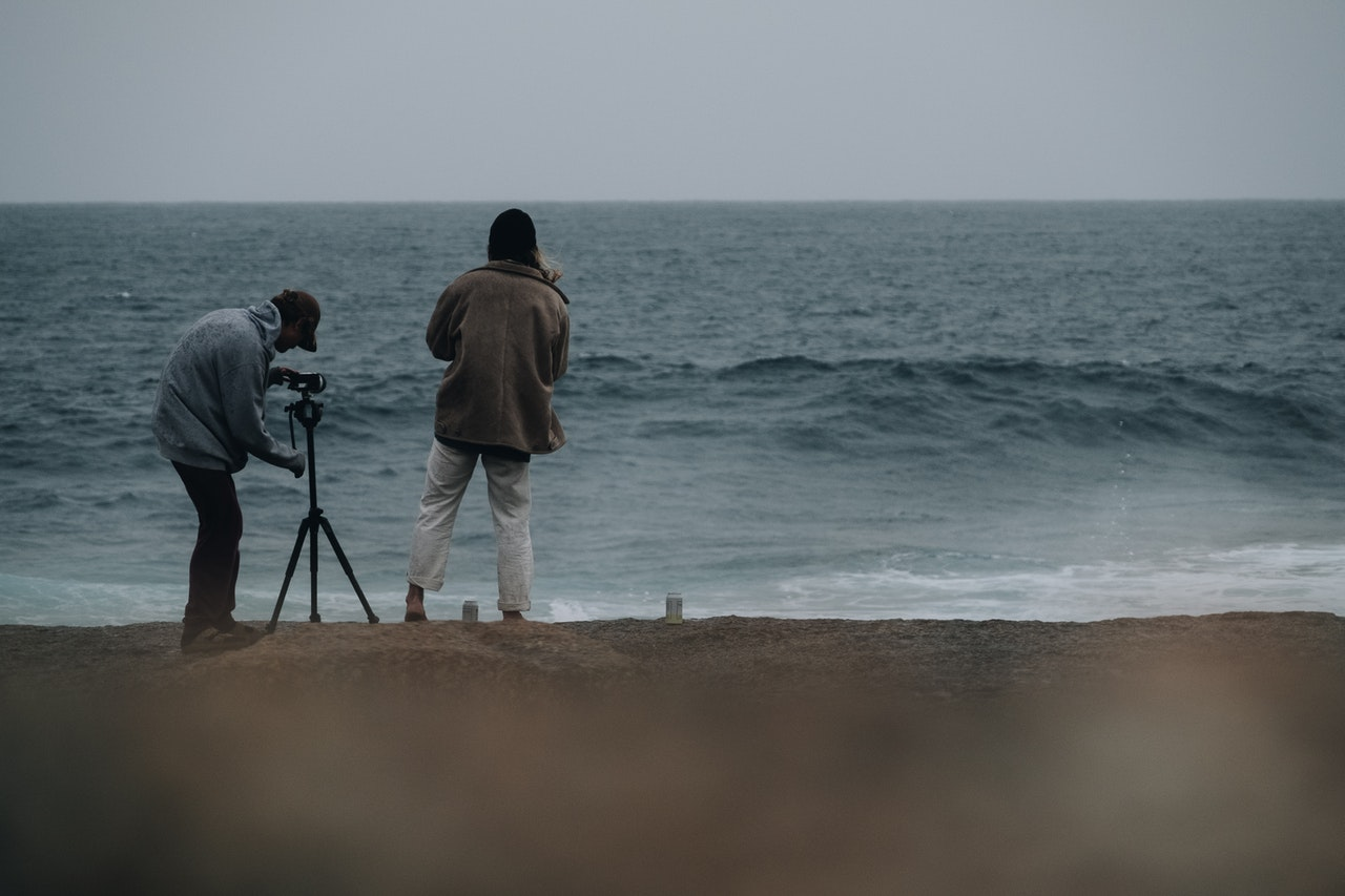 Couple recording the waves