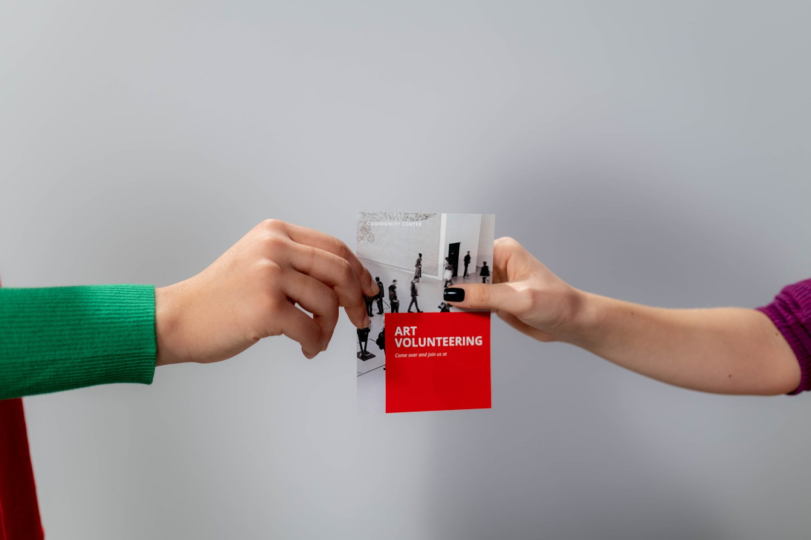 Two people holding flyer
